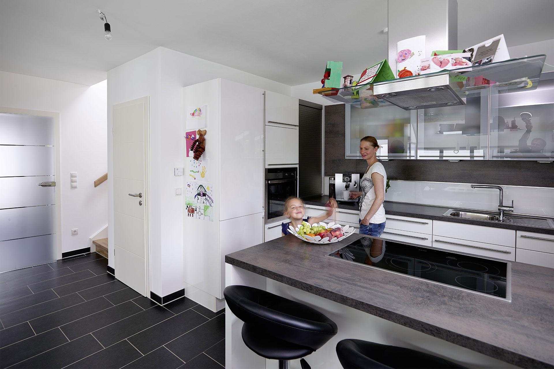 Einfamilienhaus mit Wintergarten maßgeschneidert - Modell ...